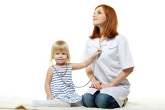 Female  doctor and small patient. Pediatrics. Stock Photos