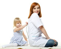 Female  doctor and small patient. Pediatrics. Royalty Free Stock Photo