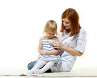 Female  doctor and small patient. Royalty Free Stock Images