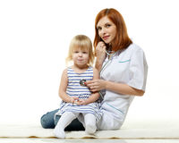 Female  doctor and small patient. Royalty Free Stock Image