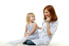 Female  doctor and small patient. Royalty Free Stock Photos