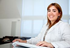 Female doctor smiling Stock Photography