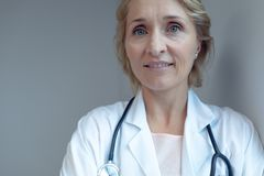 Female doctor smiling in the hospital royalty free stock photos