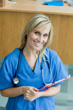 Female doctor smiling and looking at the camera Stock Photos