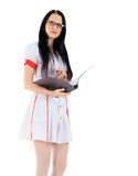 Female doctor standing with clipboard over white Royalty Free Stock Photo