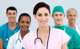 Female Doctor standing in Front of her team Stock Photography