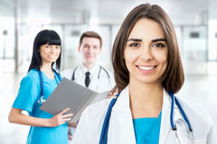 Female doctor standing in frount of his team Royalty Free Stock Image