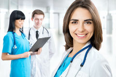 Female doctor standing in frount of his team Stock Image
