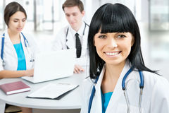Female doctor standing in frount of his team Royalty Free Stock Photo