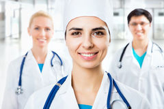 Female doctor standing in frount of his team Royalty Free Stock Photography