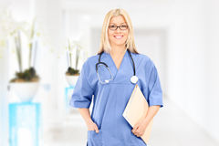 Female doctor standing in a hospital corridor Royalty Free Stock Image