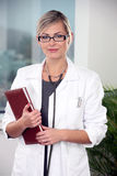 Female doctor with stethoscope. Young female doctor with stethoscope Stock Images