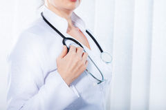 Female doctor with stethoscope. Royalty Free Stock Photos