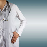 Female doctor and stethoscope on blurred background. Concept of Stock Images