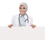 Female doctor with stethoscope holding blank white board isolated on white background Stock Photo