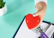 Female doctor with the stethoscope holding heart.  royalty free stock photo