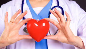 Female doctor with the stethoscope holding heart.  royalty free stock images