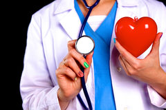 Female doctor with the stethoscope holding heart.  stock images