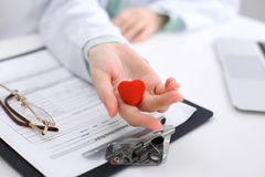 Female doctor with stethoscope holding heart. Cardio therapeutist, physician make cardiac physical, heart rate measu. Re, arrhythmia, old age life concept royalty free stock photo