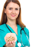 Female doctor with stethoscope holding pills in her hand Stock Photography