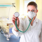 Female doctor with stethoscope Stock Images