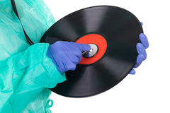 Female doctor with stethoscope and music plate Royalty Free Stock Photography