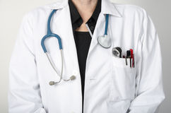 Female doctor with a stethoscope at neck, not face visible Stock Photos