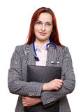 Female doctor with stethoscope and notes. A female doctor, veterinary physician or general practitioner. Also could be a vet, surgeon, medical registrar or royalty free stock photography