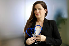 Female doctor with stethoscope overmedical  background Royalty Free Stock Images