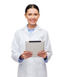 Female doctor without stethoscope and tablet pc Stock Image