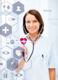 Female doctor with stethoscope and virtual screen. Healthcare, medical and future technology concept - female doctor with stethoscope and virtual screen Royalty Free Stock Photos