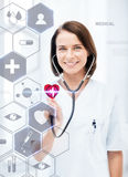 Female doctor with stethoscope and virtual screen Stock Photo