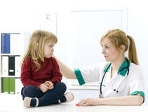 Female doctor studies small young girl Royalty Free Stock Photo