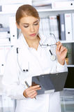 Female doctor in surgery Stock Image
