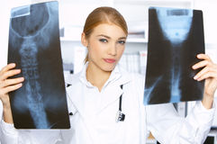 Female doctor in surgery Stock Photos