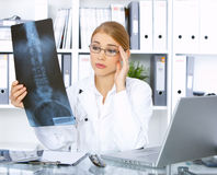 Female doctor in surgery Royalty Free Stock Image