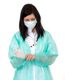 Female doctor  on surgical gloves Stock Photography