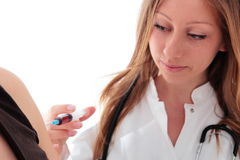 Female doctor with syringe doing a Vaccination Stock Photos