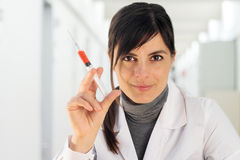 Female doctor with syringe Stock Photo