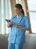 Female doctor with tablet computer Royalty Free Stock Photography