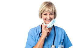 Female doctor takes off his mask Royalty Free Stock Images