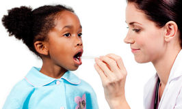 Female doctor taking little girl's temperature Stock Photos