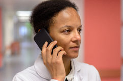 Female doctor talking on a mobile phone Stock Image