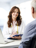 Female doctor talking with old patient Stock Photo