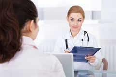 Female doctor talking with patient Stock Image