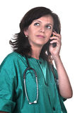 Female doctor talking on the phone Royalty Free Stock Photos