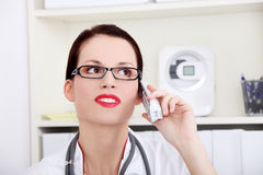 Female doctor talking by the phone. Stock Images