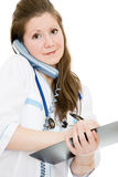 Female doctor talking on the phone Royalty Free Stock Photography
