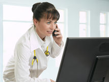 Female doctor talking on telephone Royalty Free Stock Image