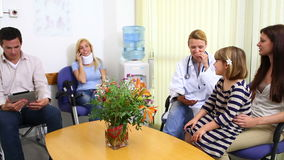Female doctor talking to patient in a waiting room Royalty Free Stock Photo